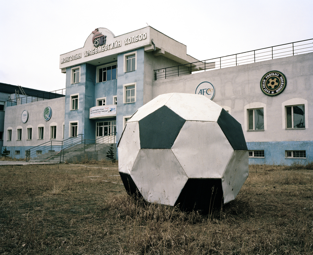The Mongolian Football Federation stadium, Ulaanbaatar, April 2014. Mongolia's equivalent of Wembley Stadium was built in 2001 using a 10 million pound grant from FIFA. Although the facilities should of only cost 3 million, the full 10 million was absorbed into the construction. With only 2 regulation size pitches in the country, the MFF stadium sees 80% of all Mongolian football, however without a roof the season is forced to shut down for more than half the year because of the freezing conditions.