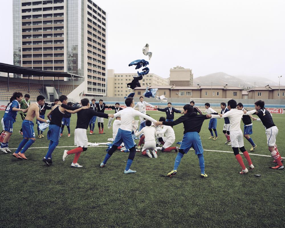 Players perform a Mongolian tradition after enjoying cup success at the MFF Stadium, April 2014, Ulaanbaatar.