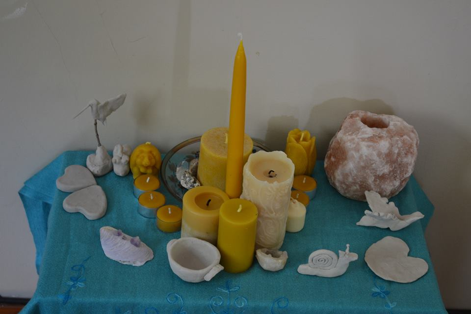 My birth altar with the candles gifted to me at my blessing way ans clay sculptures made by the women who attended my blessing way.