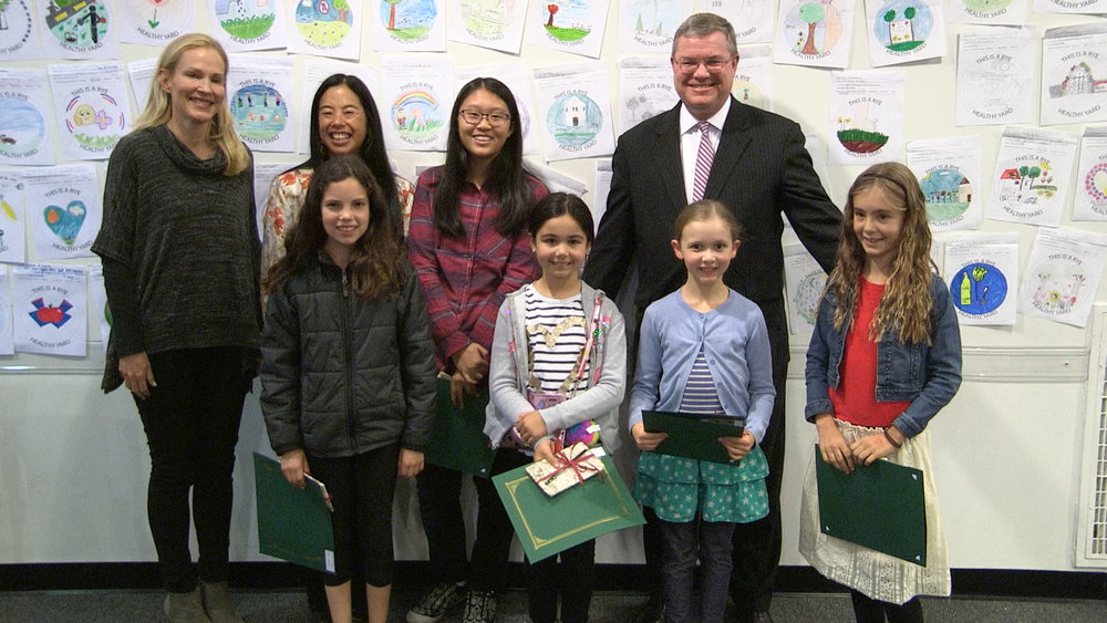 Contest winners Reese Wolfe, Charlotte Lee, Julia Zanolin, Liv McNamara and Mattia Gibbs, with RSC chair Sara Goddard, Rye Arts Center board member Jen Sandling and Mayor Sack.
