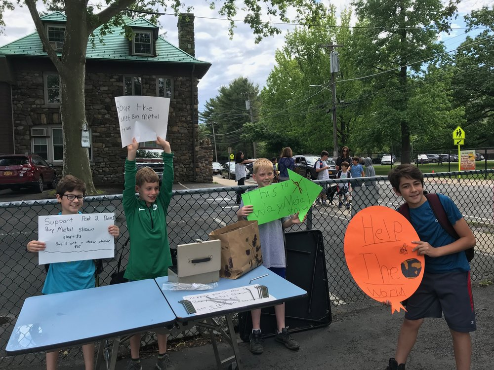 Members of Boy Scout Pack 2 Den selling metal straws at Midland Elementary School.