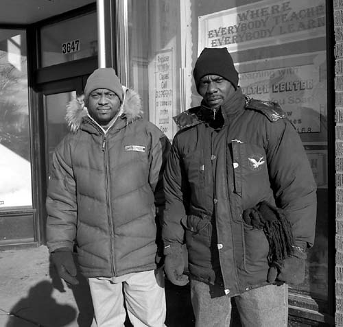 "Morton Walker and Shawn Baldwin in front of the Chicago Bee Branch Public Library where they were arrested on January 7 as part of the ""State Street Coverage Initiative."""
