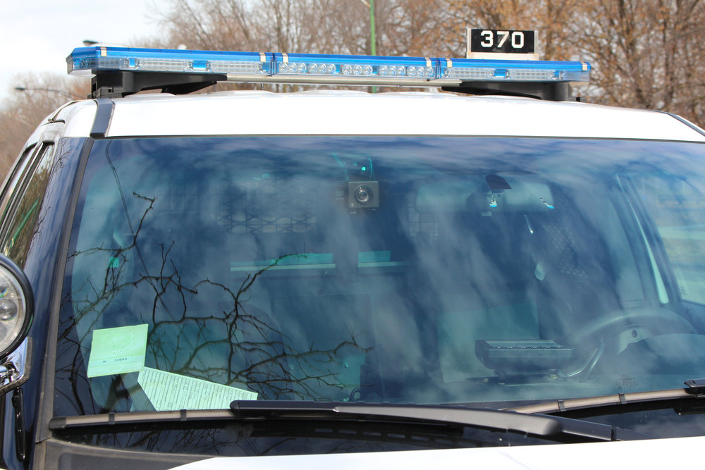 In-car camera system mounted on windshield of CPD squad car.