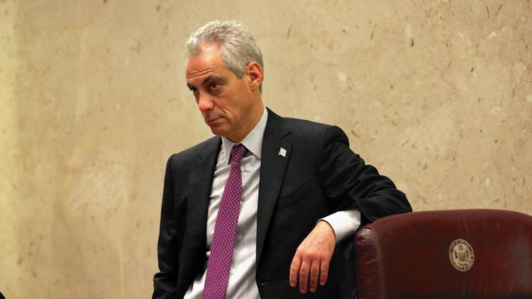 Mayor Rahm Emanuel listens as aldermen speak in favor of the resolution to create a task force looking into police misconduct, at the Chicago City Council on Dec. 9, 2015. (Nancy Stone / Chicago Tribune)