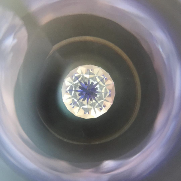 Checking the symmetry on one of the stones we faceted, it created a psychedelic portal to another world.