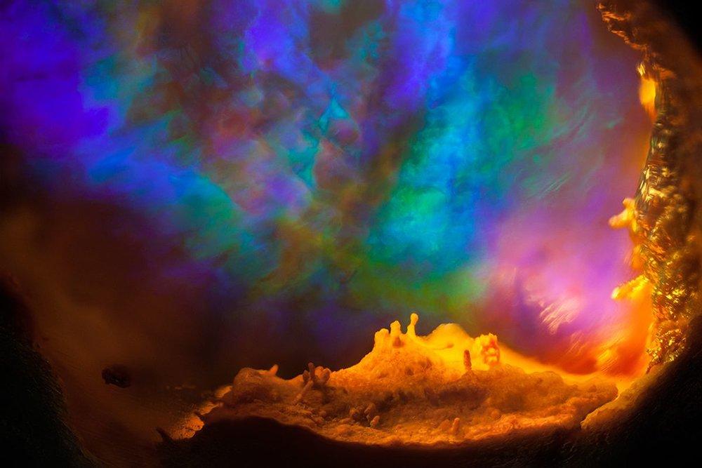 Aurora Internalis © Danny J Sanchez    Opal in rhyolite. Mexico Field of view = 6.8mm • Depth of field = 4.3mm