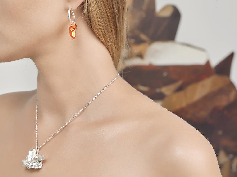 HotRocks Trigonal Pendant in Silver and Hoop Earring in Orange Low Res.jpg