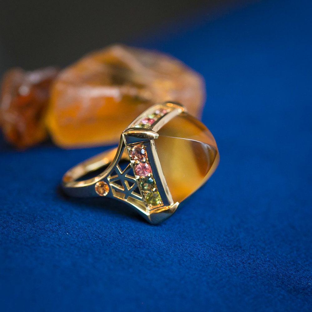 Citrine sugarloaf ring with pastel sapphire halo in 18ct recycled yellow gold