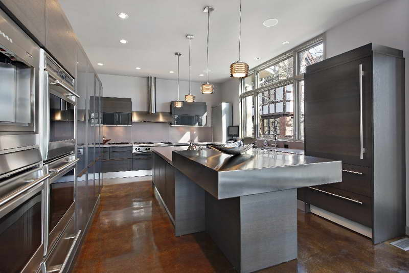 Stainless-Steel-Kitchen-Table-With-Hanging-Lamp.jpg