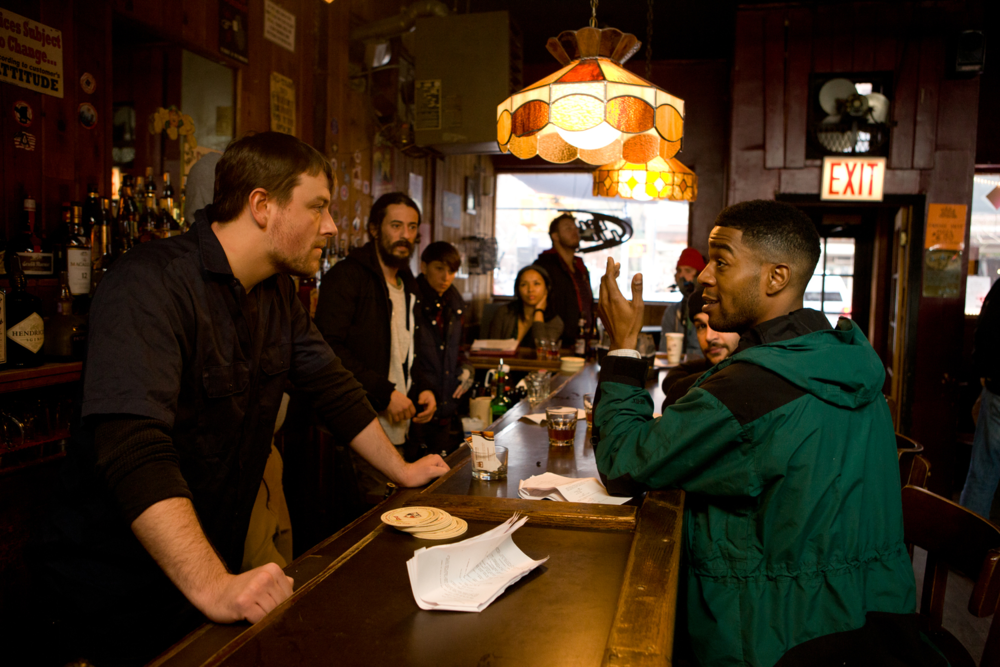 "Director Josh Mond (center) with Scott ""Kid Cudi"" Mescudi (right) on set."