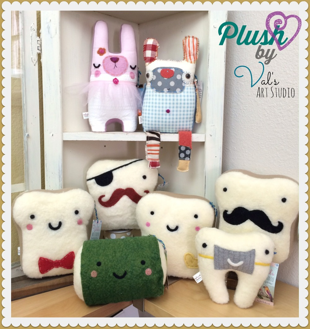 Cute plushies by Val's Art Studio brighten up any corner of a shop!