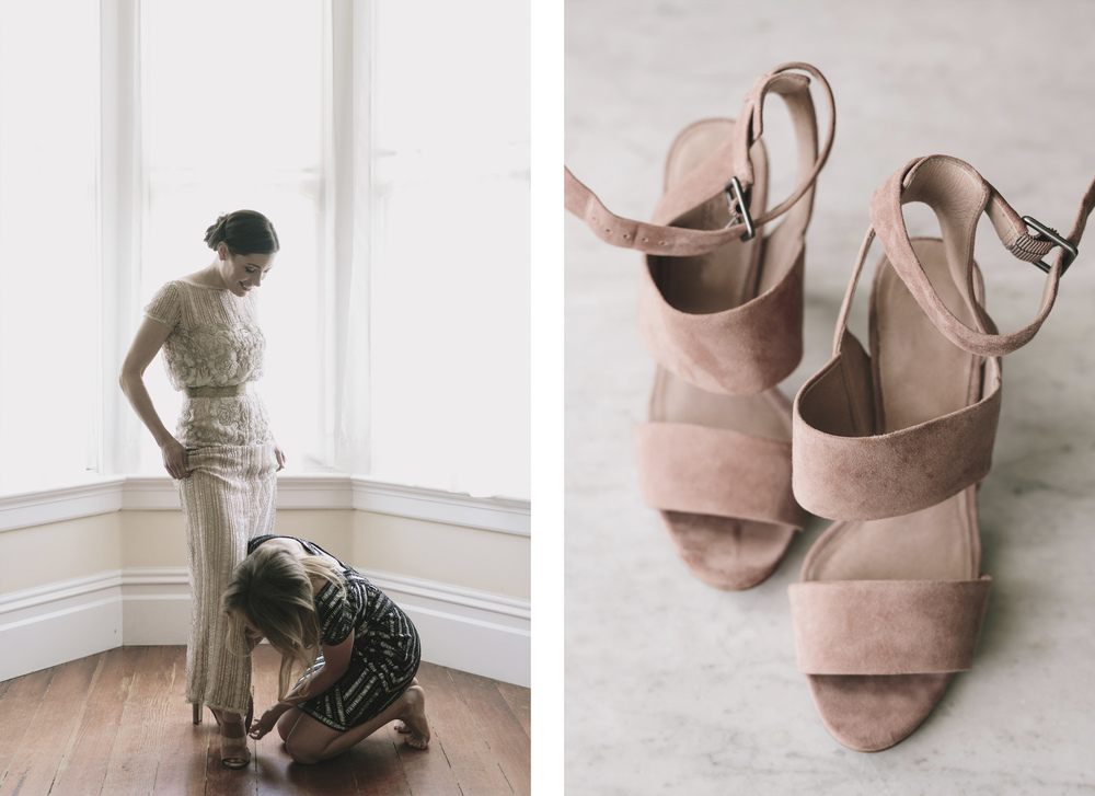 bride putting pink shoes on