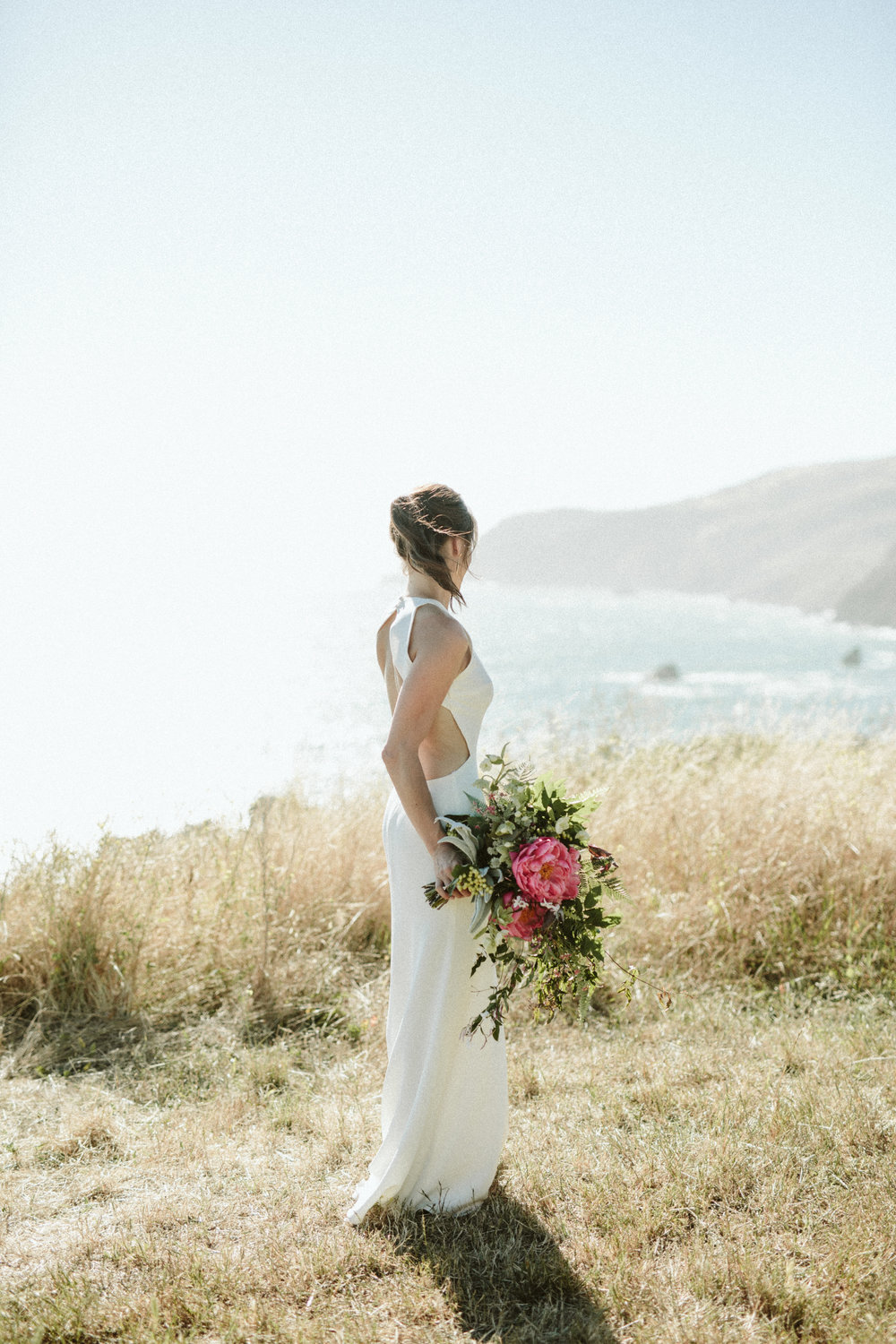 bride overlooking the California coastline - slide ranch wedding kelly brown photographer