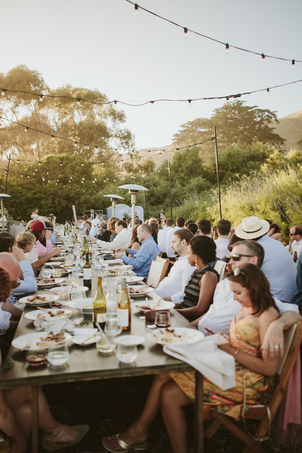 outdoor wedding reception with bistro lights, slide ranch california