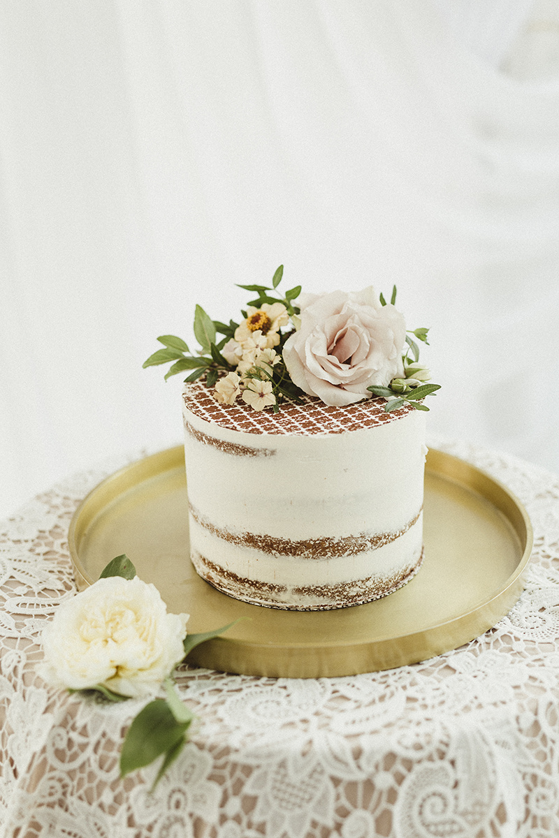 romantic naked wedding cake with flowers