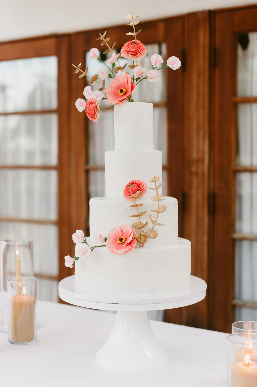 tiered wedding cake with sugar flowers