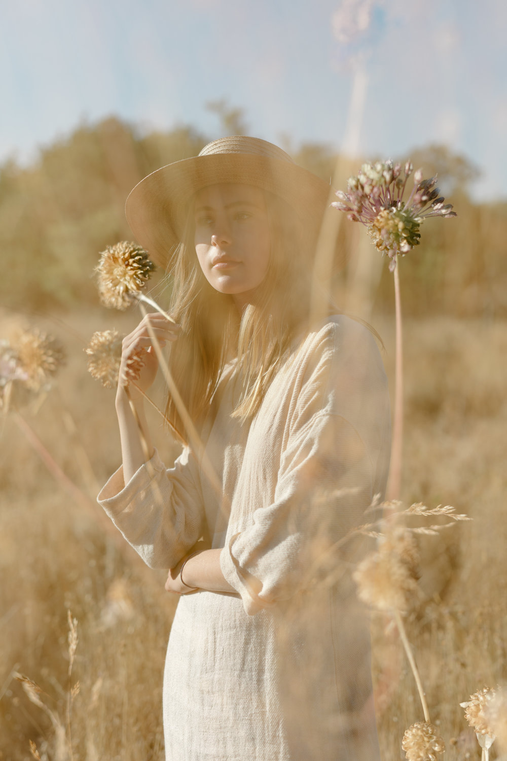 girl in a grass field double exposure, fashion photography, handwoven clothing woven wares victoria bc
