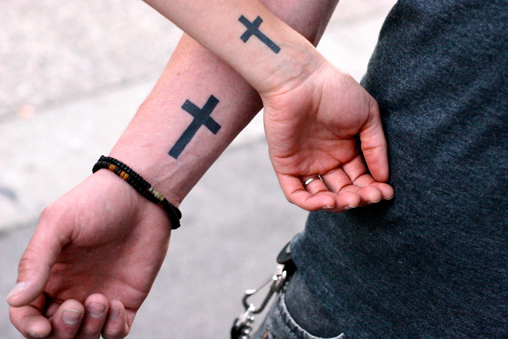 Photo: kris krüg from Vancouver, Canada (Jesus is So Cool - Matching Couples Tattoos), via Wikimedia Commons