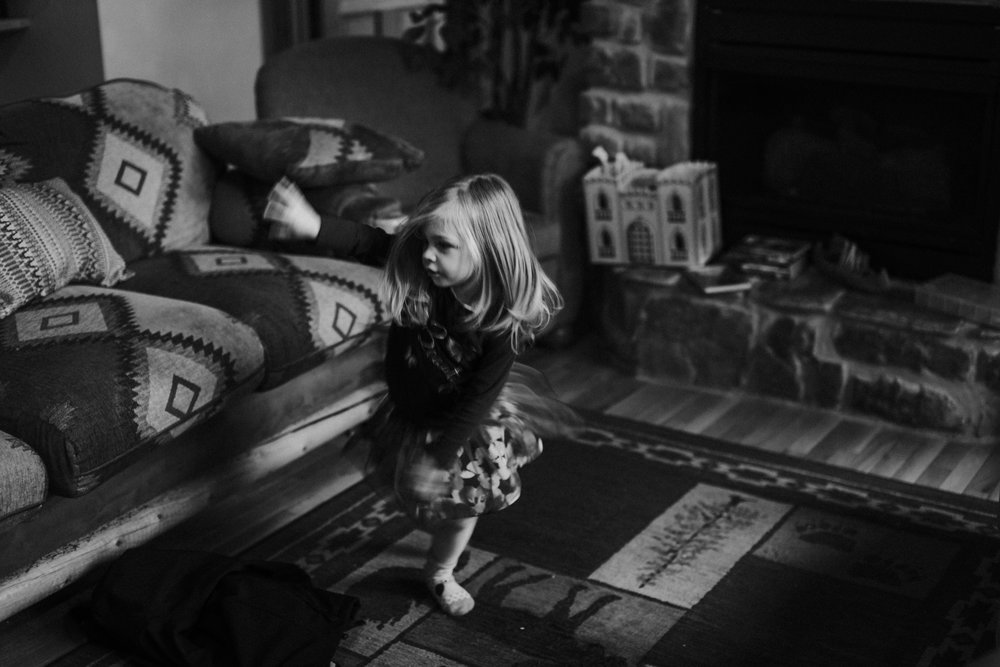 Christmas 2016 | Hannahill Photography | Branson, MO | Documentary Family Photography | a black and white portrait of my neice dancing like no one is watching