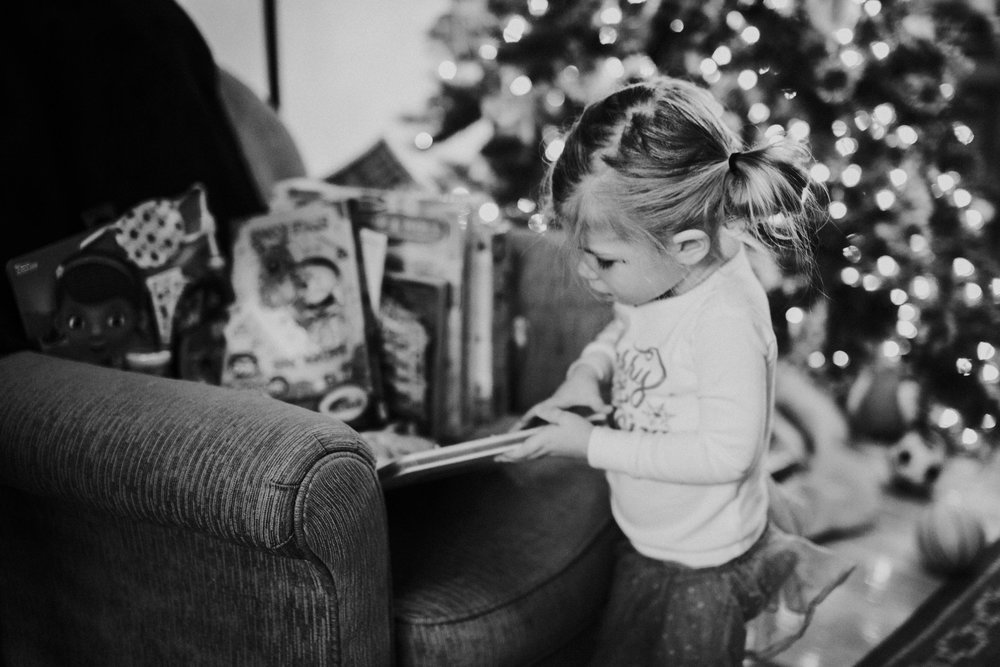 Christmas 2016 | Hannahill Photography | Branson, MO | Documentary Family Photography | a portrait of my niece opening up her gifts on Christmas Morning