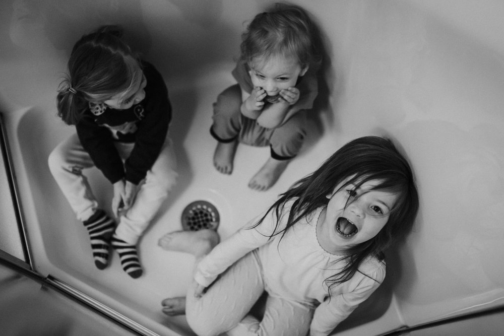 Christmas 2016 | Hannahill Photography | Branson, MO | Documentary Family Photography | a black and white portrait of my nieces playing in the shower stall