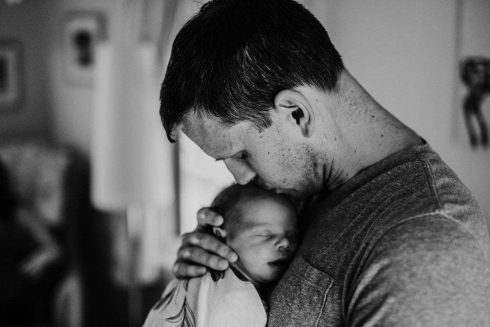 Father and newborn son sweet moment together in black and white | Paul O Lifestyle Newborn Session | Hannahill Photogrraphy | Kansas City, MO | Family photography in home