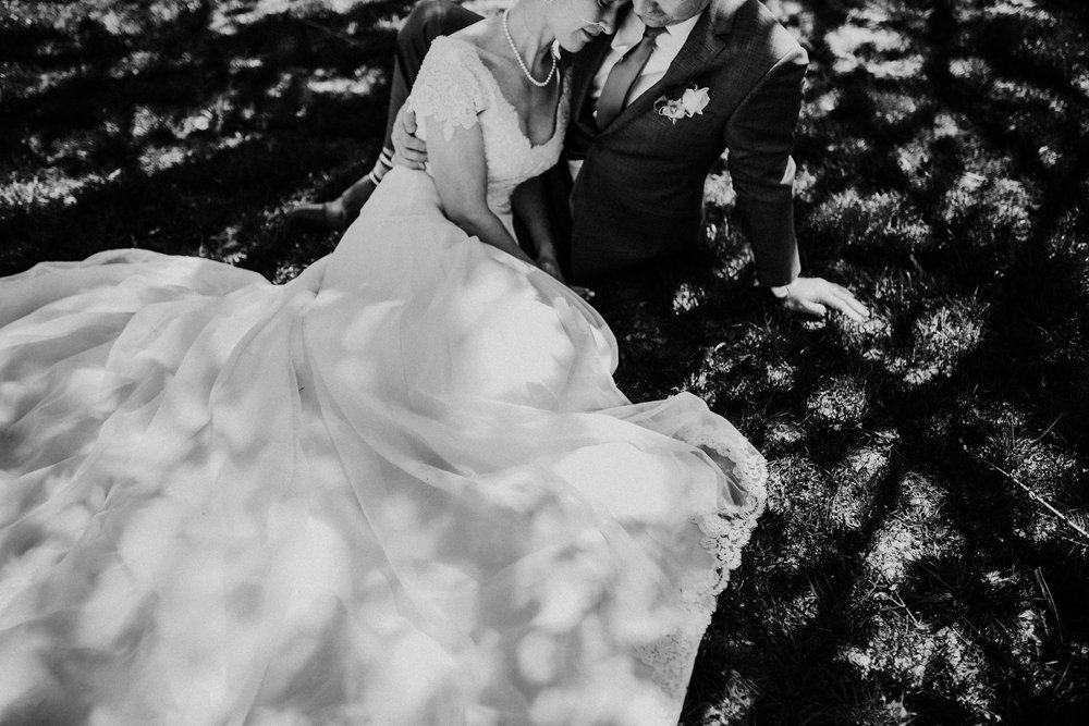 Bert & Lauren's North Kansas City Spring Wedding | Hannahill Photography | Raleigh Durham Photographer | North Carolina Wedding Photography | Family Photographer | Wedding photographer | the couple cuddles together under a tree in black and white