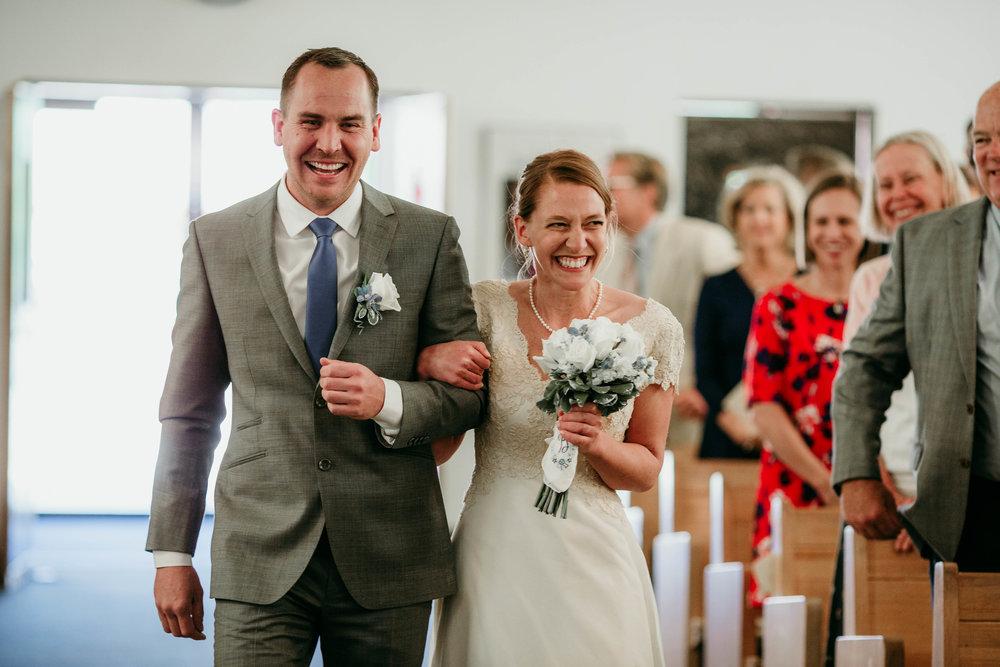 Bert & Lauren's North Kansas City Spring Wedding | Hannahill Photography | Raleigh Durham Photographer | North Carolina Wedding Photography | Family Photographer | Wedding photographer | the couple walks down the aisle