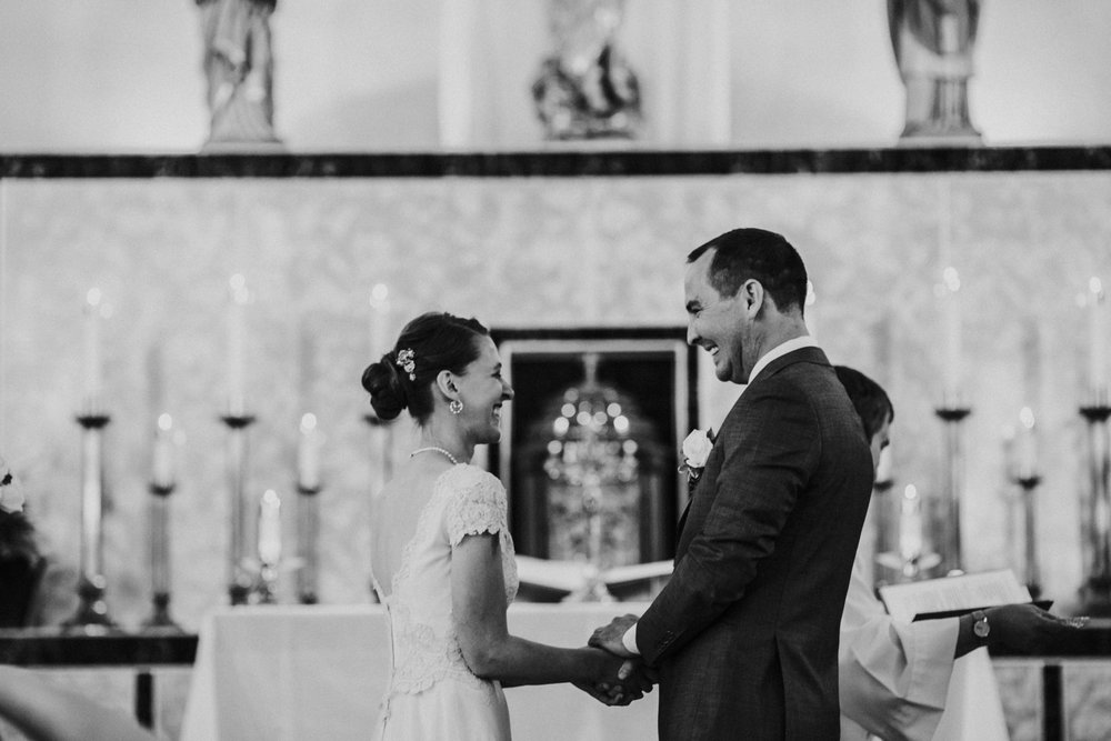 Bert & Lauren's North Kansas City Spring Wedding | Hannahill Photography | Raleigh Durham Photographer | North Carolina Wedding Photography | Family Photographer | Wedding photographer | The bride and groom smiling over their vows during the ceremony