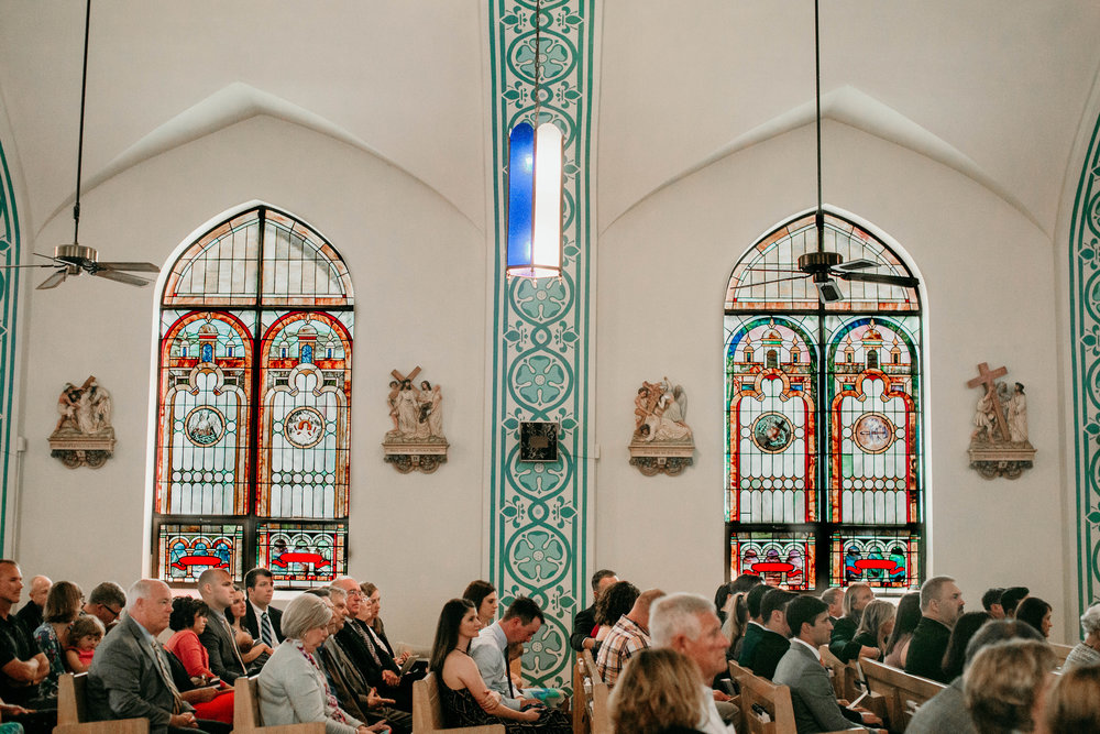 Bert & Lauren's North Kansas City Spring Wedding | Hannahill Photography | Raleigh Durham Photographer | North Carolina Wedding Photography | Family Photographer | Wedding photographer | gorgeous stained glass windows in the ceremony space at Lauren and Bert's catholic wedding