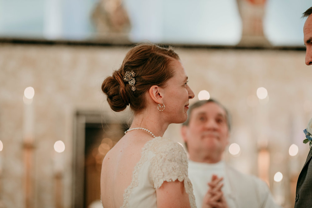 Bert & Lauren's North Kansas City Spring Wedding | Hannahill Photography | Raleigh Durham Photographer | North Carolina Wedding Photography | Family Photographer | Wedding photographer | The bride at the alter during the ceremony