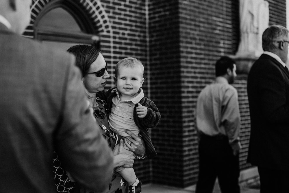 Bert & Lauren's North Kansas City Spring Wedding | Hannahill Photography | Raleigh Durham Photographer | North Carolina Wedding Photography | Family Photographer | Wedding photographer | one of the cutest guests wait to celebrate the bride and groom after the ceremony in black and white
