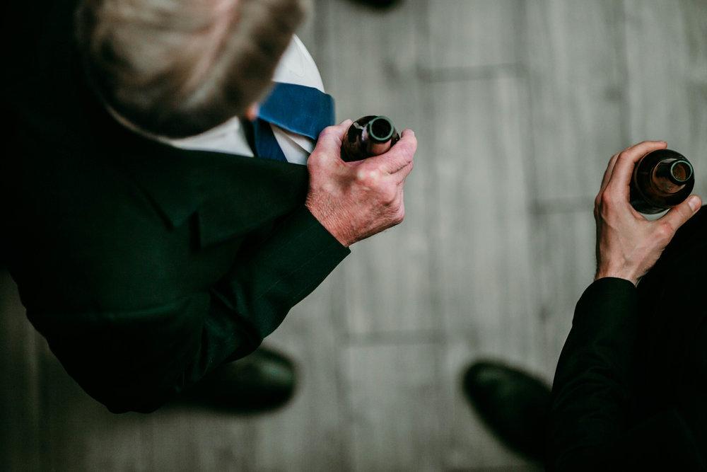 Bert & Lauren's North Kansas City Spring Wedding | Hannahill Photography | Raleigh Durham Photographer | North Carolina Wedding Photography | Family Photographer | Wedding photographer | Father and groom share a beer at the reception