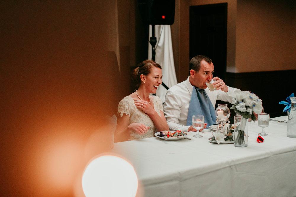 Bert & Lauren's North Kansas City Spring Wedding | Hannahill Photography | Raleigh Durham Photographer | North Carolina Wedding Photography | Family Photographer | Wedding photographer | the bride and groom enjoy their first meal as husband and wife
