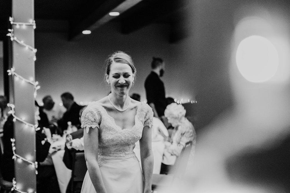 Bert & Lauren's North Kansas City Spring Wedding | Hannahill Photography | Raleigh Durham Photographer | North Carolina Wedding Photography | Family Photographer | Wedding photographer | the bride celebrates at the reception