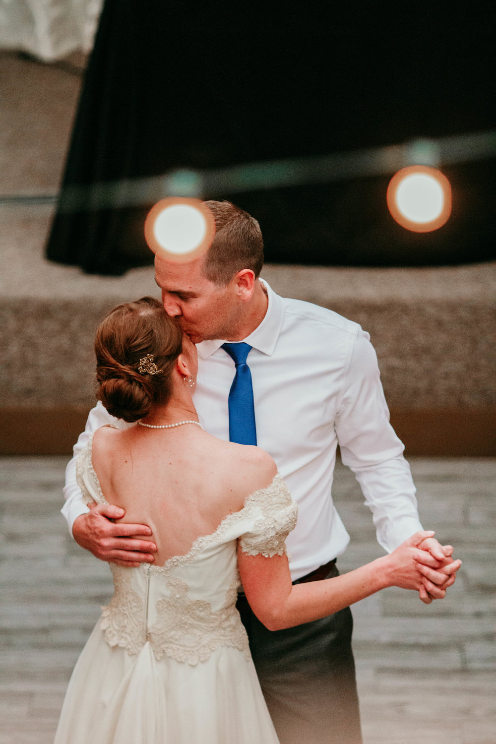 Bert & Lauren's North Kansas City Spring Wedding | Hannahill Photography | Raleigh Durham Photographer | North Carolina Wedding Photography | Family Photographer | Wedding photographer | Groom kisses brides forehead in their first dance