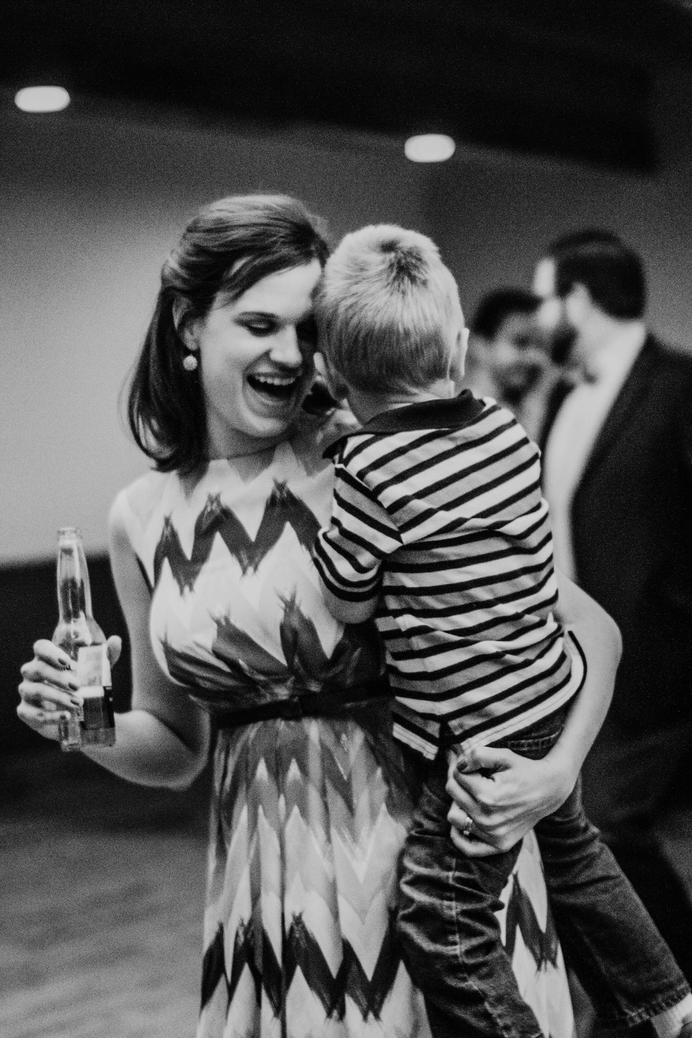 Bert & Lauren's North Kansas City Spring Wedding | Hannahill Photography | Raleigh Durham Photographer | North Carolina Wedding Photography | Family Photographer | Wedding photographer | sweet mom and son dance during the reception in black and white