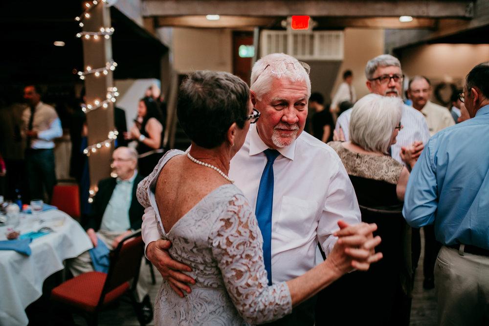 Bert & Lauren's North Kansas City Spring Wedding | Hannahill Photography | Raleigh Durham Photographer | North Carolina Wedding Photography | Family Photographer | Wedding photographer | the grooms parents share a sweet dance at the reception