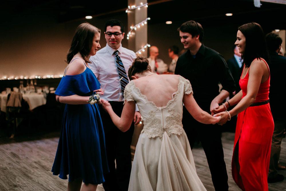 Bert & Lauren's North Kansas City Spring Wedding | Hannahill Photography | Raleigh Durham Photographer | North Carolina Wedding Photography | Family Photographer | Wedding photographer | teh bride dances with cousins and siblings
