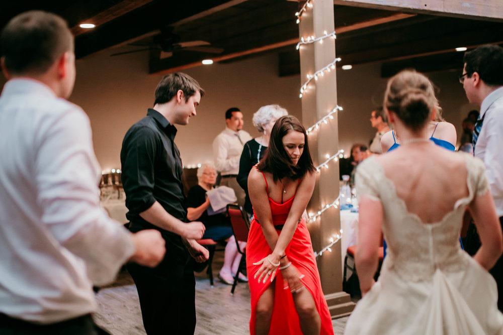 Bert & Lauren's North Kansas City Spring Wedding | Hannahill Photography | Raleigh Durham Photographer | North Carolina Wedding Photography | Family Photographer | Wedding photographer | guests get down at the reception
