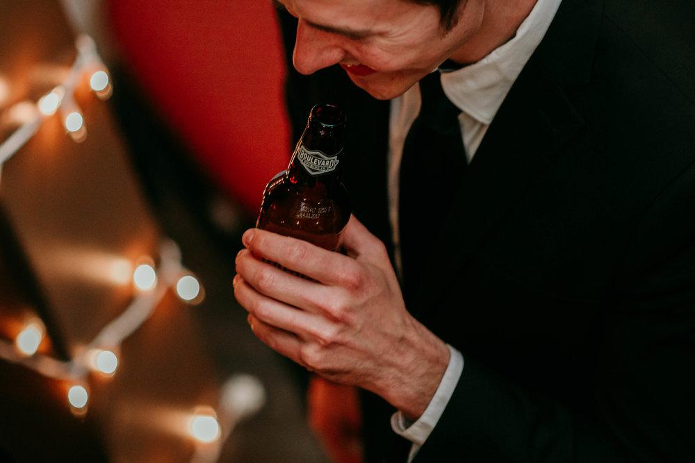 Bert & Lauren's North Kansas City Spring Wedding | Hannahill Photography | Raleigh Durham Photographer | North Carolina Wedding Photography | Family Photographer | Wedding photographer | reception of the wedding close up beer