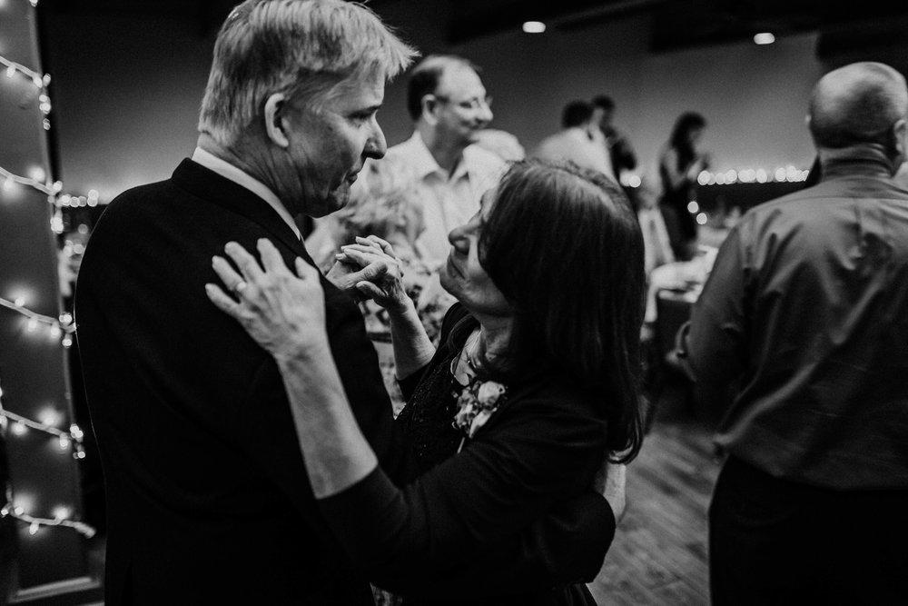 Bert & Lauren's North Kansas City Spring Wedding | Hannahill Photography | Raleigh Durham Photographer | North Carolina Wedding Photography | Family Photographer | Wedding photographer | bride's parents share a sweet dance at the reception