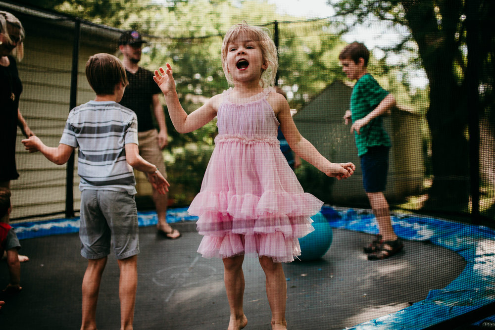 Siblings having fun on the trampoline after dressing themselves in their favorite fun outfits.   The Carter Family : Summer in the Backyard | Hannahill Photography | Kansas City, MO | Family photography lifestyle photographer | Wedding photographer Durham North Carolina Raleigh | Birth photographer Documentary