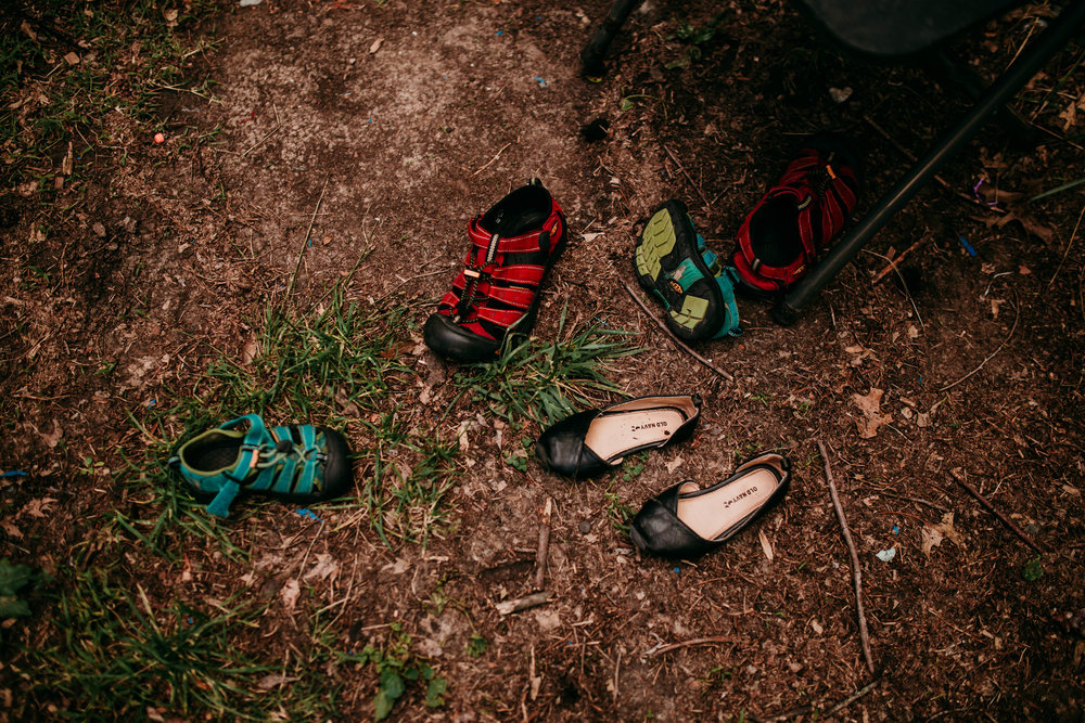 Kids leave there shoes in the grass while they jump on the trampoline in the Backyard.   The Carter Family : Summer in the Backyard | Hannahill Photography | Kansas City, MO | Family photography lifestyle photographer | Wedding photographer Durham North Carolina Raleigh | Birth photographer Documentary
