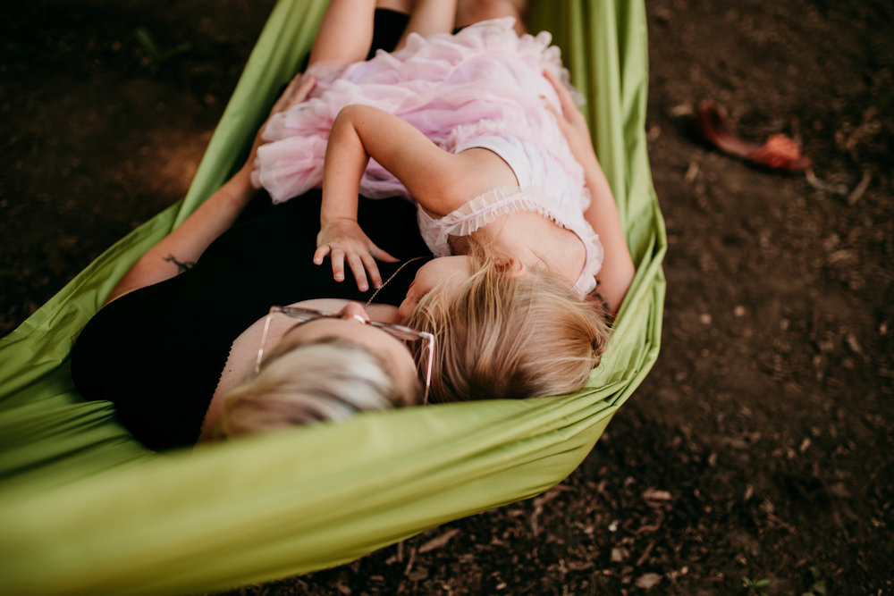 Mom and daughter cuddle on the hammock in the backyard  The Carter Family : Summer in the Backyard | Hannahill Photography | Kansas City, MO | Family photography lifestyle photographer | Wedding photographer Durham North Carolina Raleigh | Birth photographer Documentary