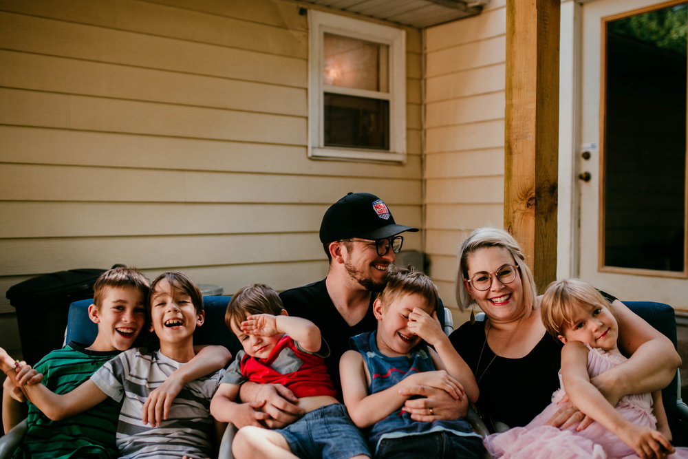 The whole family laughs together on the back porch  The Carter Family : Summer in the Backyard | Hannahill Photography | Kansas City, MO | Family photography lifestyle photographer | Wedding photographer Durham North Carolina Raleigh | Birth photographer Documentary