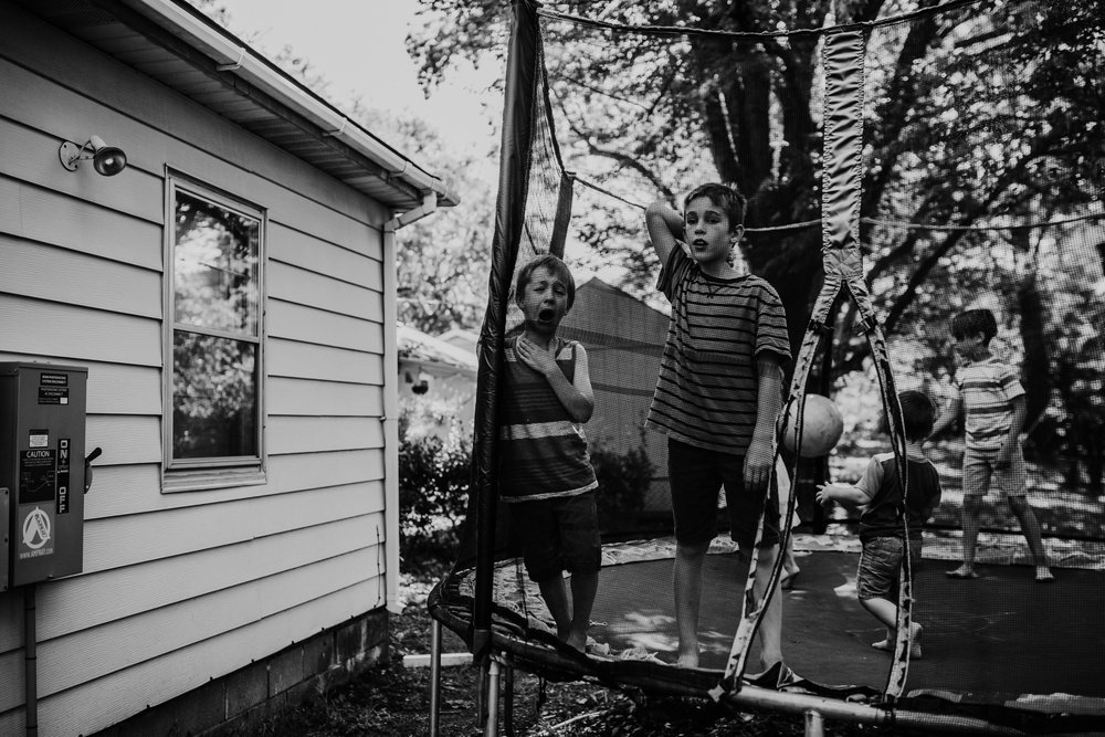 A real moment of siblings in black and white  The Carter Family : Summer in the Backyard | Hannahill Photography | Kansas City, MO | Family photography lifestyle photographer | Wedding photographer Durham North Carolina Raleigh | Birth photographer Documentary