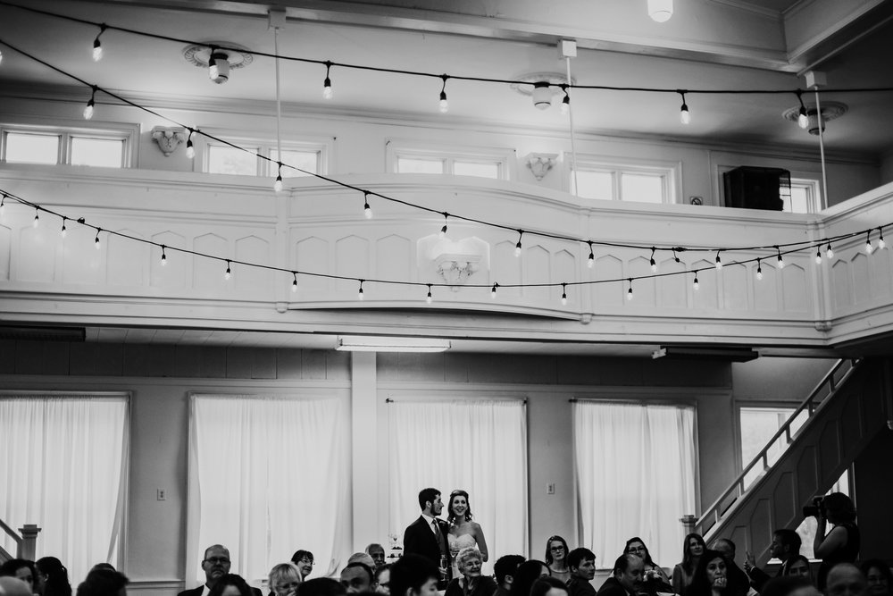 toasts at the reception of Shelbie & Jospeh's Summer Love Story : Kansas City Wedding | Hanna Hill Photography