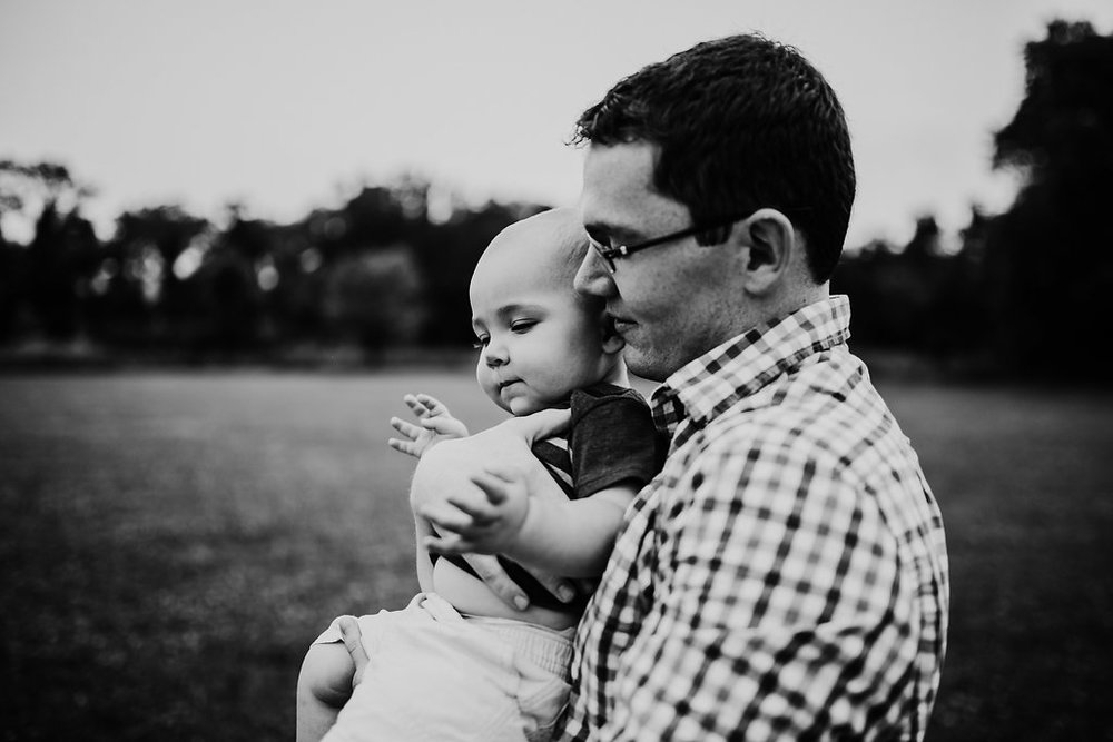 father and son black and white photo | Family session at Tomahawk Creek park in Overland Park, kS | The McCoy Family | Hanna Hill Photography | Raleigh/Durham, NC Family Photographer