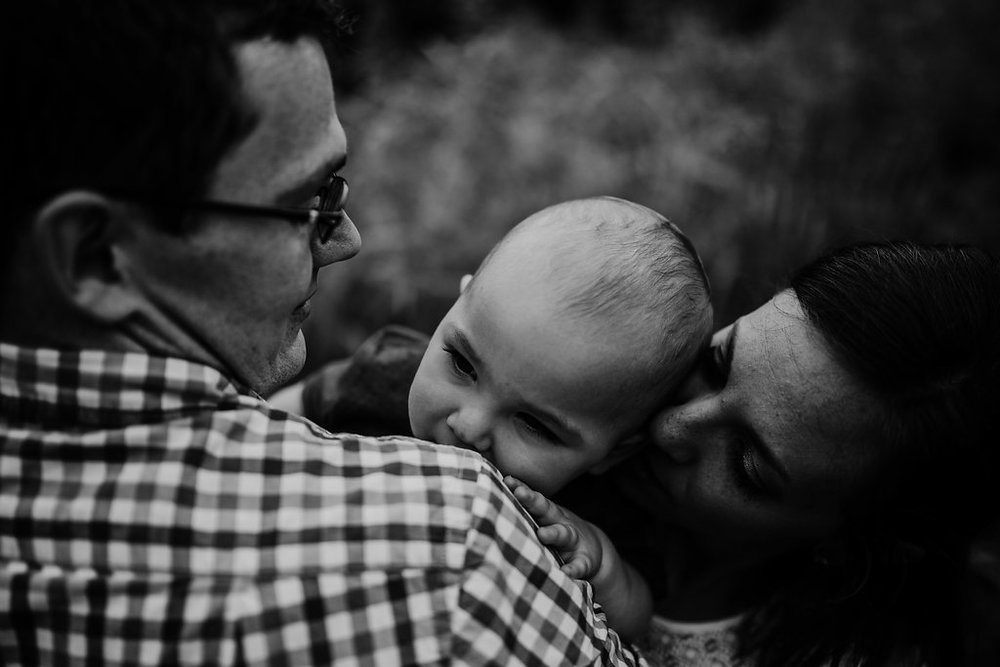 sweet back and white close up of family moment| Family session at Tomahawk Creek park in Overland Park, kS | The McCoy Family | Hanna Hill Photography | Raleigh/Durham, NC Family Photographer